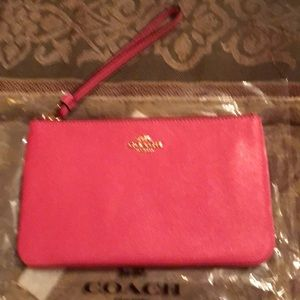 Large leather pink wristlet by Coach New